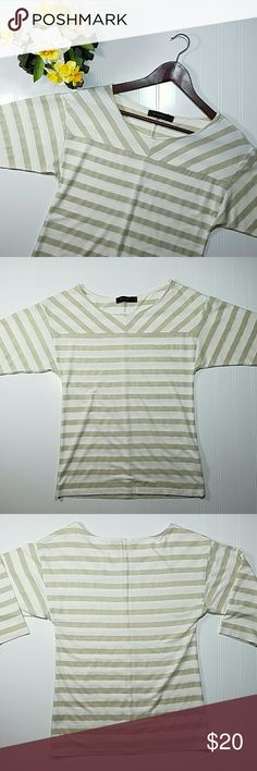 The Limited top Gold and cream striped knit top, 3/4 length sleeves. The gold stripes have a metallic look to them. Rayon/nylon/spandex/metallic. Excellent condition.  Sz small The Limited Tops