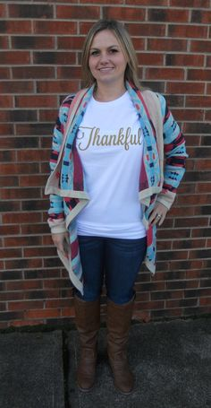 """Let everyone know how completely thankful you are! Perfect for Thanksgiving, the Holidays, or any time in between. Easily dressed up with a fun necklace and vest or cardigan, or casual wear.For ladies, this item fits TTS/Slightly Big. We suggest you order your normal size, unless you like a fitted shirt or are in between sizes, you will want to size down. Men, there will be a slightly fitted bicep and chest.Sizing: XS - Length,27"""", Width, 17""""S - Length, 28..."""
