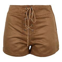 Estos son pantalones cortos y los pones en tu caderas. Es todo marrón. La marca es Sybilla.