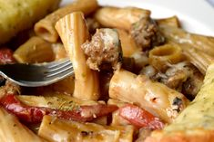 Rigatoni & Italian Sausage Skillet Meal is a hearty one pan dish that's easy enough for weeknights. Loaded with flavor you'll love this simple dish. Sausage Recipes, Pork Recipes, Cooking Recipes, Pasta Recipes, Dinner Recipes, Dinner Entrees, Drink Recipes, Healthy Recipes, Sausage Meals
