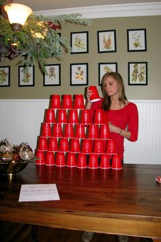 Minute to win it  Using all the cups; build a Symmetrical Christmas Tree shape.