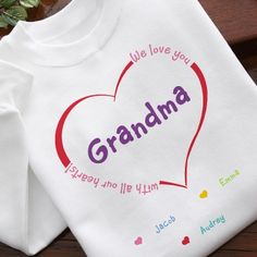 "Personalized Grandma T Shirt with up to 15 Grandkids Names - Adorable shirt says ""We love you with all our hearts!"" along the heart design.  You can add any name in the middle.  Available as a sweatshirt or hoodie as well.  $22.95"