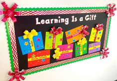 Learning is a Gift! Fun bulletin board display idea for Christmas! Have kids write their names on the stars and add to their favorite school subjects. Giant bows made from sparkle trimmers!