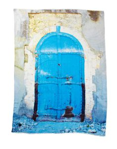 Title: Architecture 1 ... As I walked through the devastation of a 7-magnitude earthquake, I was moved by the strength and resilience of the blue Door in Rubble. I imagined in time the people of Haiti would open the door and find that life, peace, and beauty had triumphed once again.  Photo taken in Port-Au-Prince, Haiti.