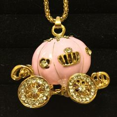 An Enchanting Princess Carriage Necklace This is so precious! Pretty pink carriage with a long golden chain. Lovely! Guaranteed to create smiles! No trades. Please be respectful and don't lowball offers. Betsey Johnson Jewelry Necklaces