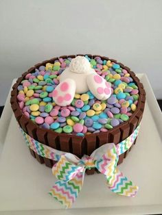 like the bunny idea. thinking carrot cake...crushed walnuts around the edge, with walnuts and 'dug up' mini eggs?: