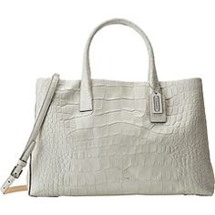 WHOLESALE COACH Bleecker Pinnacle Matte Croc Studio PURSES  http://www.ashpants.com/wholesale-coach-purses  The distinctive texture of crocodile embossing lends uptown glamour to our sophisticated studio tote. Great for office or weekends, the spacious, well-organized design is finished with precise edge-painting and a slender, vachetta-lined strap for hands-free wear.