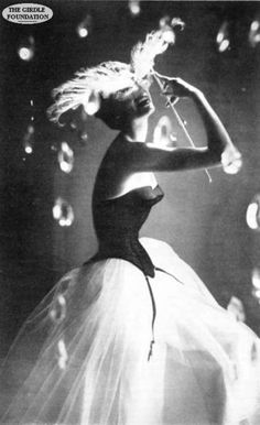 """Warner's Merry Widow Corset advertisement, 1952 - """"It's simply wicked what it does for you."""" Photo by Lillian Bassman."""