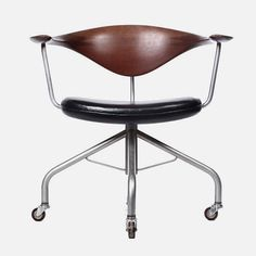Swivel chair by Hans Wegner for Danish cabinetmaker Johannes Hansen, designed in 1955