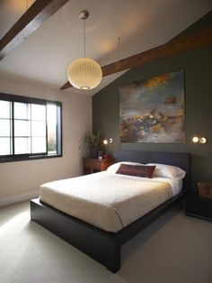 Choosing a minimalist, low bed and simplistic decorations creates a clutter-free room that brings out your Zen.