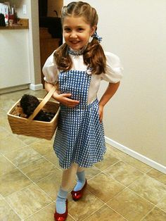 Dorothy with Toto. All you need is gingham cotton print to make the dress. The white cotton for the blouse.