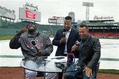 David Ortiz laugh while broadcasting with former Red Sox players Manny Ramirez and Kevin Millar on the field at Fenway Park prior to the game.