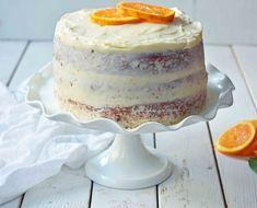 Homemade Orange Cake with Sweet Orange Cream Cheese Frosting. How to make the best orange cake. Orange cake with orange frosting. Naked orange cake. www.modernhoney.com #cake #orangecake #nakedcake #nakedorangecake