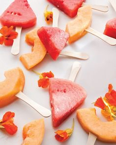 Frozen Melon-Margarita Pops:  3/4 cup tequila  1/2 cup Grand Marnier  1/2 cup fresh lime juice  Pinch of coarse salt  8 ounces cantaloupe, rinds removed  8 ounces watermelon, rinds removed.  Stir together tequila, Grand Marnier, fresh lime juice, and coarse salt in a large bowl. Cut cantaloupe and watermelon into wedges. Soak in tequila mixture for 15 minutes. Insert ice-pop sticks into wedges. Freeze on a rack-lined baking sheet for 1 hour.