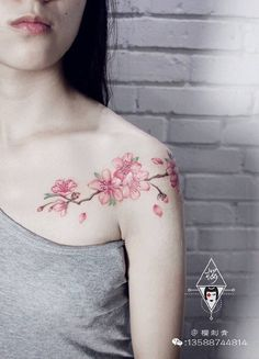 From the shoulder to the collarbone plum tattoo