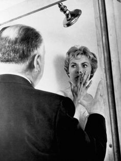 Janet Leigh and Alfred Hitchcock on the set of Psycho (1960)