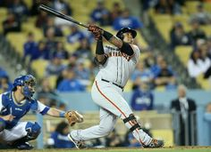 LOS ANGELES, CA - MAY 08: Pinch hitter Hector Sanchez #29 of the San Francisco Giants hits a sacrifice fly to bring in the go ahead run in the tenth inning against the Los Angeles Dodgers at Dodger Stadium on May 8, 2014 in Los Angeles, California. (Photo by Stephen Dunn/Getty Images)