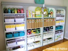 Raising up Rubies: a cute place to make stuff ♥    4 bookshelves together with crown molding to look like built ins    i WANT this in my studio!!