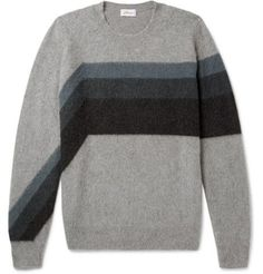 Venerable Italian label Brioni is famed for sourcing the most luxurious materials. This sumptuous cashmere and camel-blend sweater has a fleecy finish and a remarkably soft handle, so you can be assured of its comfort. The tonal-grey and petrol asymmetric stripes add a contemporary touch to the design. Try yours with smart navy trousers and leather sneakers.