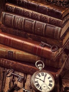 Brown books with keys and watch