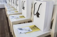 Goody bags at a sit down seminar event - with corporate branded paper bags