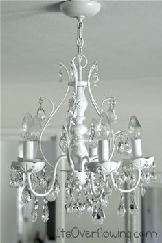 Old crystal chandelier spray-painted white
