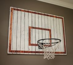 We had a large empty wall in the boys' playroom. I thought briefly about making a big bulletin board to hang their drawings, but thought they'd have much more fun with a basketball hoop! I wanted t...