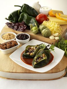 Chile Rellenos with California Raisins, Cheese, Pecans and Guajillo Chile Sauce
