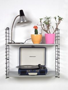 Mid-century Dutch design metal wall system from Tomado with two deep grey shelves. This wall system offers room for your record player, some of your art books or some houseplants.