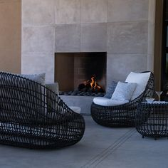 Vino looks cozy indoors or out! Featuring Vino Sofa, Vino Lounge Chair, and Vino Side Table | luxurious living room | cozy fireplace seating | luxury modern indoor | modern outdoor seating