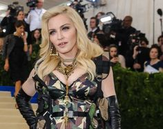 "Madonna has urged people to ""never give up"" on their dreams as she opened a new hospital wing in Malawi on Tuesday (11Jul17)  named after the daughter she fought to adopt."