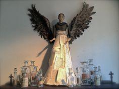 discoverattic: Santos Doll, Angel Wings. http://discoverattic.com (attic.©2014)