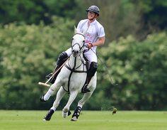 Prince Harry racing over the polo field.