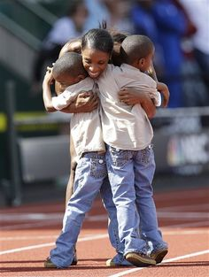 """Lashinda Demus clearing all sorts of hurdles to compete at the Olympics - cheered on by her twins, """"GO MOMMY!"""""""