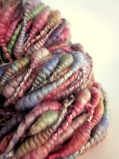 Handspun coiled blue faced leicester knitting yarn -weaving - greens, blues and pinks uk Diy Tricot Crochet, Crochet Wool, Wool Yarn, Knitting Yarn, Spinning Wool, Hand Spinning, Textiles, Native Beadwork, Loom Patterns