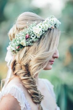 There is something about a summertime braid that exudes a carefree and whimsical bridal look. With so many fun choices and unique styles, braids look great on every bride. For a sweet summer bridal style, pair a fishtail braid with a baby's breath flower crown. See more summer #wedding inspiration at mywedding.com.