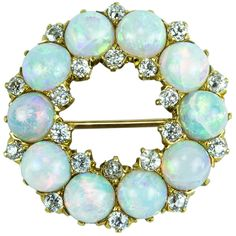 Antique Edwardian Opal Diamond Gold Circle Brooch Pin. Exquisite Edwardian Circle of Fiery Opals accented by Diamonds and set in 18k gold. Circa 1900.