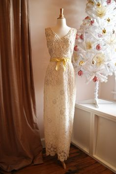 """Favorite vintage cut-out lace wedding gown from the 1960's. Waist 28"""". Available at Xtabay Vintage Bridal Salon."""