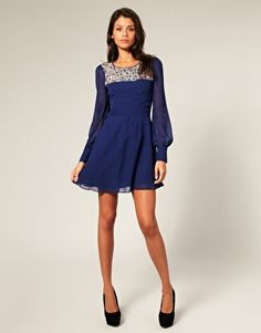 i think the sleeves add a good twist to a regular short dress
