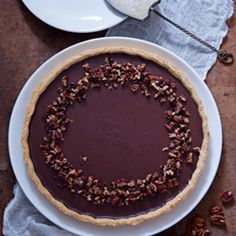 A decadent tart filled with gooey caramel, chocolate & pecans!