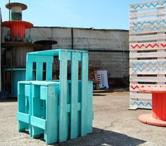 pallet tables, with teal paint scuffed to look rustic and old