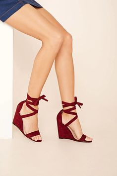 a6f0b9fc11c1 A pair of faux suede wedges with a lace-up ankle and a single toe