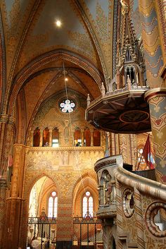Inside Matthias Church, Budapest, Hungary with its gorgeous painted walls and ceilings.