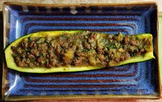 Zucchini boats stuffed with coconut curry lamb.  I LOVED IT!  Used ground beef instead of lamb though.  Too bad the hubs doesn't like curry... I'll be eating these by myself.