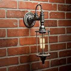 A handmade industrial chic sconce that is sure to add a truly charming accent to any home. This unique and re-imagined blend of metal pipe fittings and threaded rod create a unique light that will… Lampe Industrial, Industrial Bathroom Lighting, Industrial Chic, Vintage Industrial, Unique Lamps, Unique Lighting, Lighting Design, Pipe Lighting, Wall Sconce Lighting