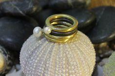 Brass multy rings by Flora Lampadinou...
