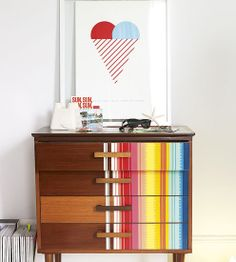 I just bought a dresser this style but longer. Half stripes might be too much, but a section could look great.