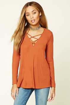 F21 Crisscross Ribbed Swing Top $18 :: A ribbed knit swing top with a crisscross cutout neckline and long sleeves.