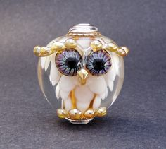 RESERVED FOR BETH - White & Gold Silver Cored and Capped bhb Owl - Hand Made Lampwork Glass Owl Bead - sra ooak Handmade Art Glass Owl Focal by PeggySudzLampwork on Etsy https://www.etsy.com/listing/179638932/reserved-for-beth-white-gold-silver