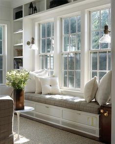 Wow-Factor Windows - Design Chic #WindowSeat #Bookcases #Books